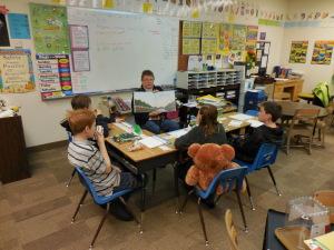 Betty Hecker reads to Ms.Kolar's 3rd & 4th grade Class